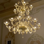 murano glass chandelier with lights on